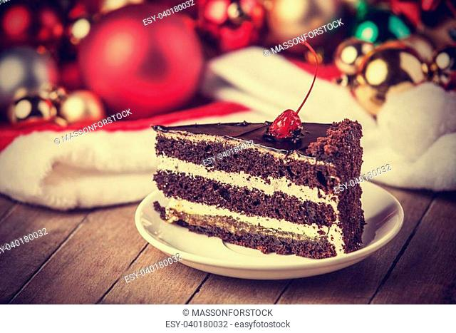Chocolate cake and chritmas gifts at background