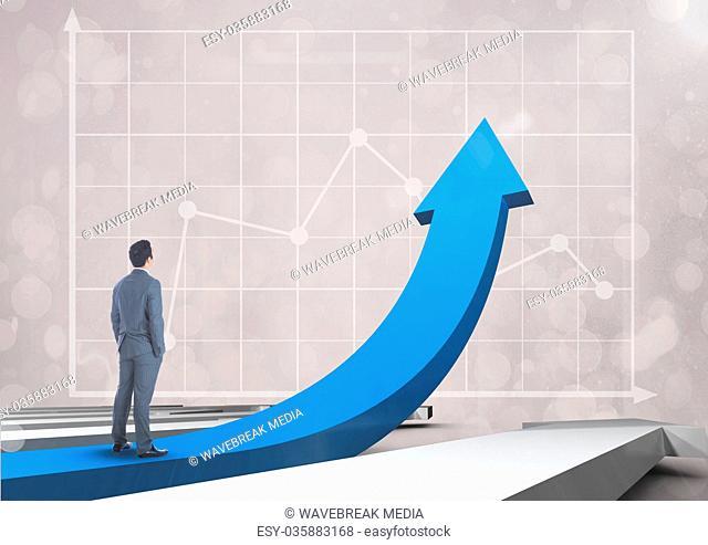 businessman standing on blue arrow