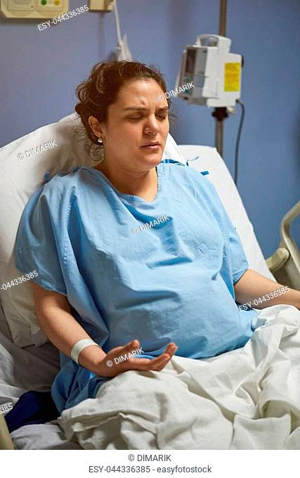 Breath breathing of patient to relieve pain in hospital room