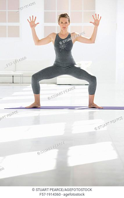 Healthy young woman in a yoga position