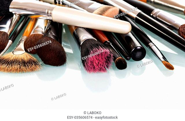 Various cosmetic brushes for makeup isolated on white background
