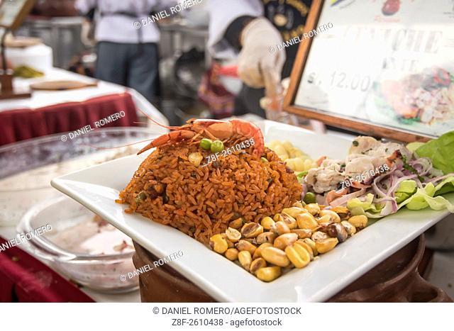"""Peruvian food dishes: """"""""Arroz con mariscos y Ceviche"""""""". Peruvian seasoning and flavor, food fair. La Limeñita boulevard, Camana Street"""