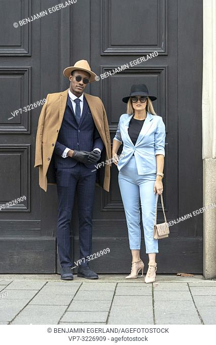 blogger couple posing in front of door at street, Munich, Germany