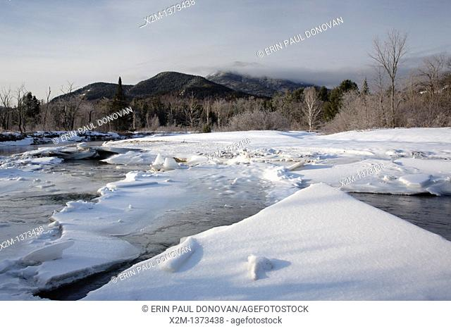 Swift River during the winter months  This river travels along side of the Kancamagus Highway route 112 which is one of New England's scenic byways in the White...