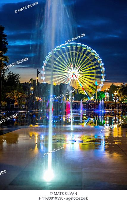 Water Fountain and Ferris Wheel in Dusk in Nice in Provence-Alpes-Côte d'Azur, France
