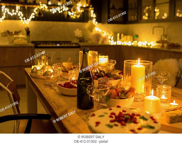 Champagne and desserts on candlelight Christmas table