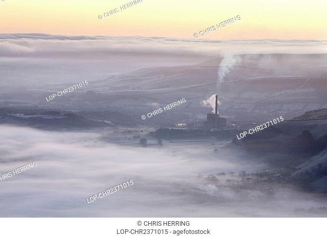 England, Derbyshire, Hope Valley. Hope Valley Cement Works shrouded in mist at sunrise in the Peak District National Park