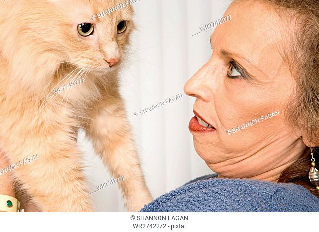 Senior woman with pet cat