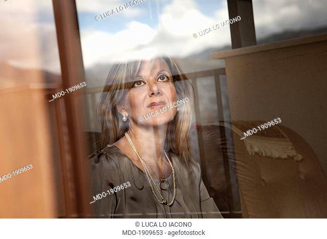 A woman behind a stained-glass window. Palermo (Italy), 27th December 2013