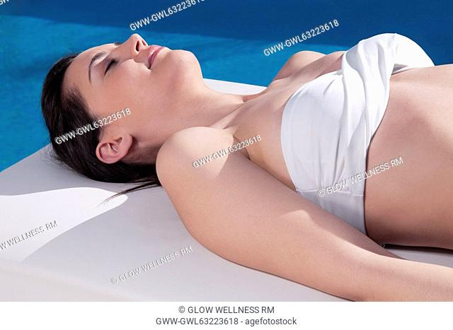 Woman sunbathing on a massage table