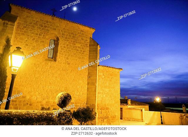 Belmonte by night Cuenca La Mancha Spain. Colegiata de San Bartolome, collegiate church with full moon
