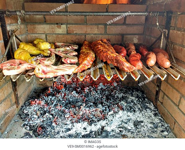 Grilling sausages, ribs and chicken. Asturias, Spain
