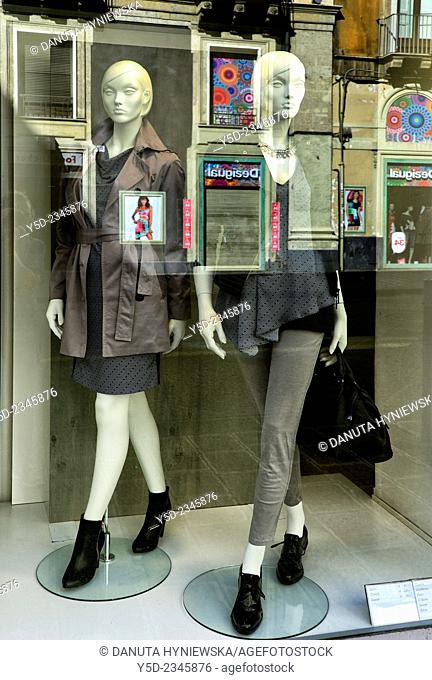 Via Etnea - main commercial street in Catania old town, boutiqe window with reflection of facades, Catania, Sicily, Italy