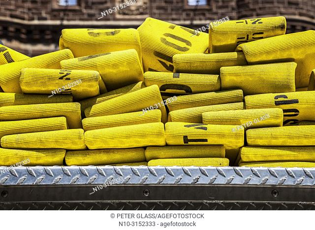 Folded yellow fire hoses