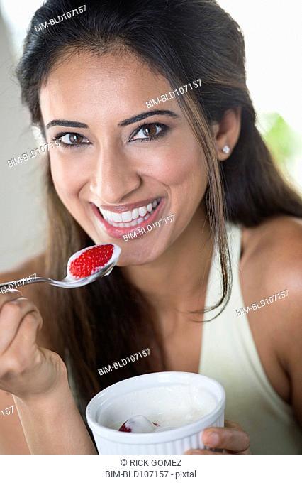 Indian woman eating fruit