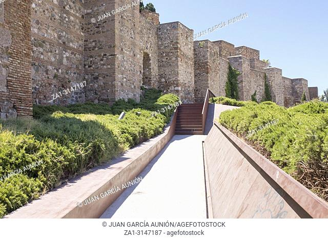 Fortifications of Malaga moorish Citadel. Surrounded by green plants
