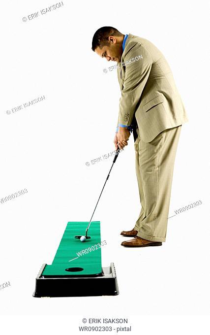 business man golfing