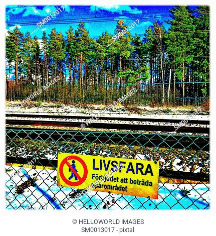 Danger of live railway tracks sign in Swedish, Sweden, Scandinavia