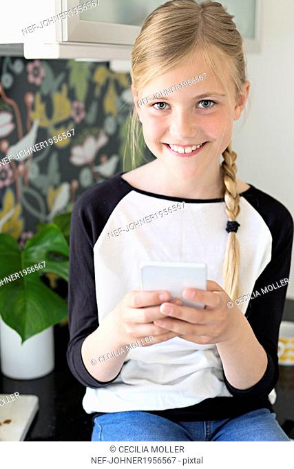 Portrait of girl holding cell phone