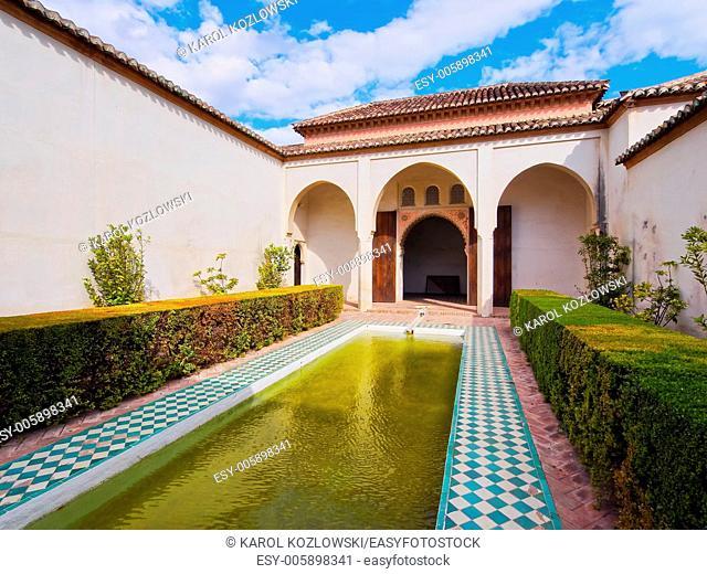 Courtyard garden of the Cuartos de Granada in the Alcazaba - old fortification in Malaga, Andalusia, Spain