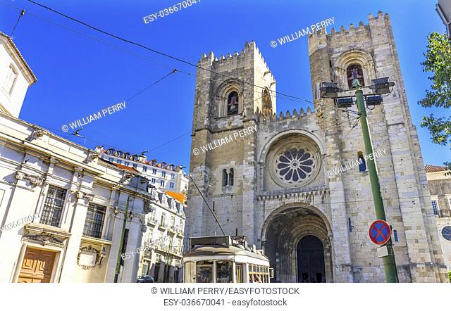 The Se Sedes Episcopalis Cathedral Trolley Lines Lisbon Portugal. The Cathedral was built in 1155 after Lisbon was taken from the Moors
