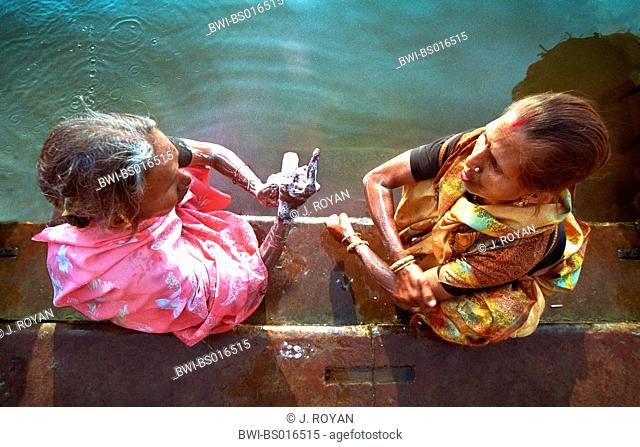 two Indian women bathing at the Ganges, holiest river of the Hindus, India, Uttar Pradesh, Varanasi