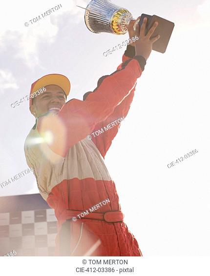 Racer holding trophy at award ceremony