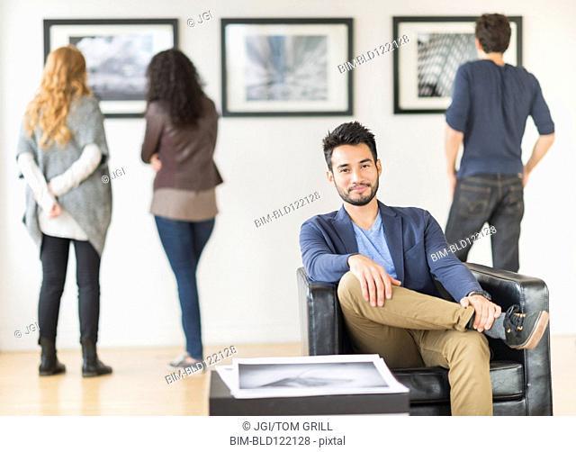 Artist smiling in art gallery