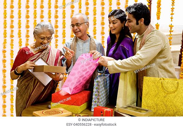Family opening Diwali gifts