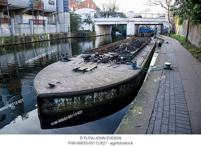 Barge with rubbish dredged from canal, near Camden Lock, Regent's Canal, Camden, London, England, February