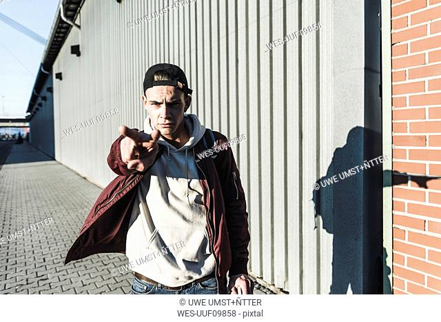 Portrait of aggressive young man gesturing