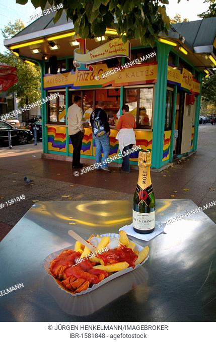 Currywurst with chips, mayonnaise, ketchup and sparkling wine, chip shop, snack bar at Wittenbergplatz square, Schoeneberg, Berlin, Germany, Europe