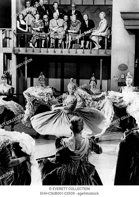 Premier Nikita Khrushchev's party watches a rehearsal for the film CANCAN. Actress Shirley MacLaine swirls surrounded by 'Cancan' dancing girls at 20th Century...