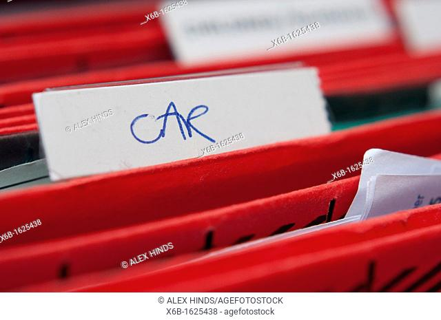 Home filing system with focus on the word car for illustrating motoring and car issues