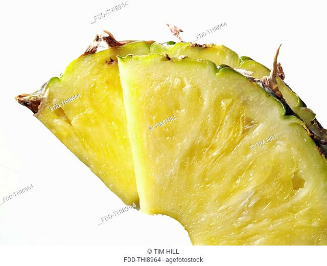 Pineapple slices on a white background