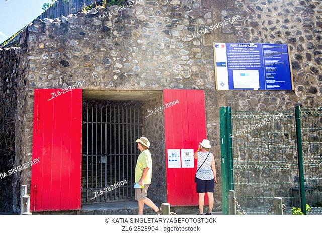 red doors of the entrance of the military Fort Saint Louis in Fort de France, Martinique