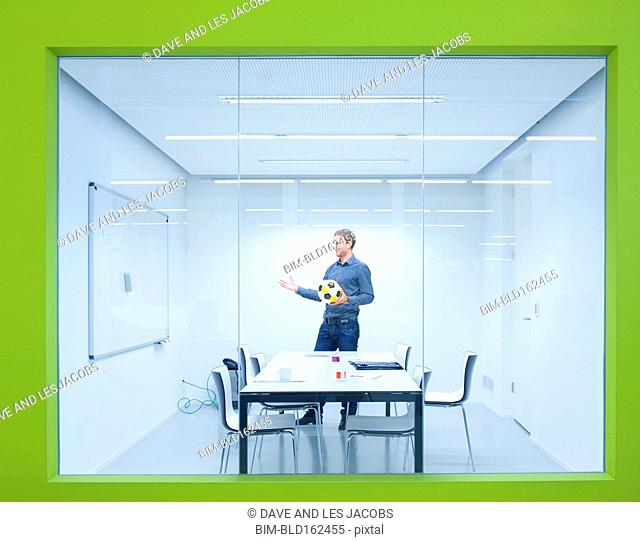 Caucasian businessman working in conference room