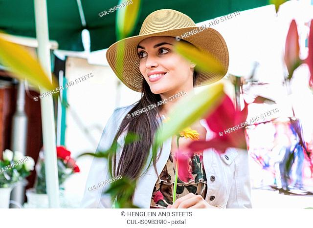 Young female tourist at flower market stall, Split, Dalmatia, Croatia