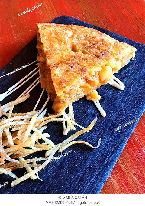 Spanish omelet with chips serving. Spain