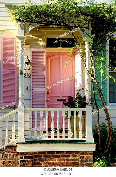 Pink door of row house in Savannah's Historic District