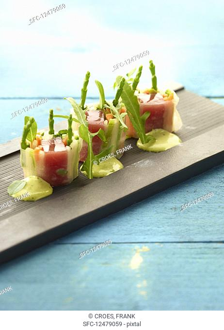 Rice paper rolls with vegetables, marinated tuna and rocket cream