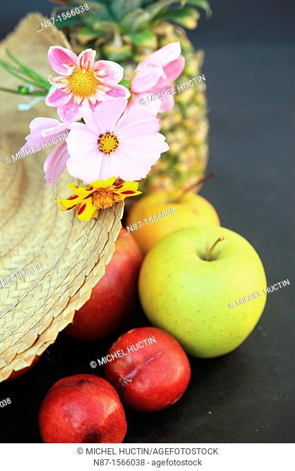 still life flowers in a Straw Hat