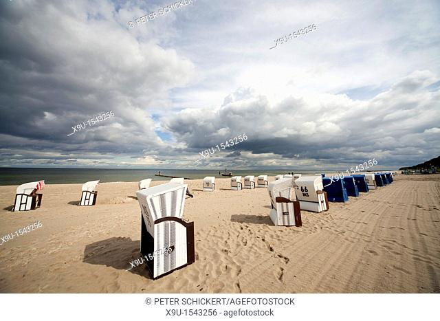 Beach chairs ' Strandkorb ' and the baltic beach of the coastal resort of Bansin, Usedom island, Mecklenburg-Vorpommern, Germany