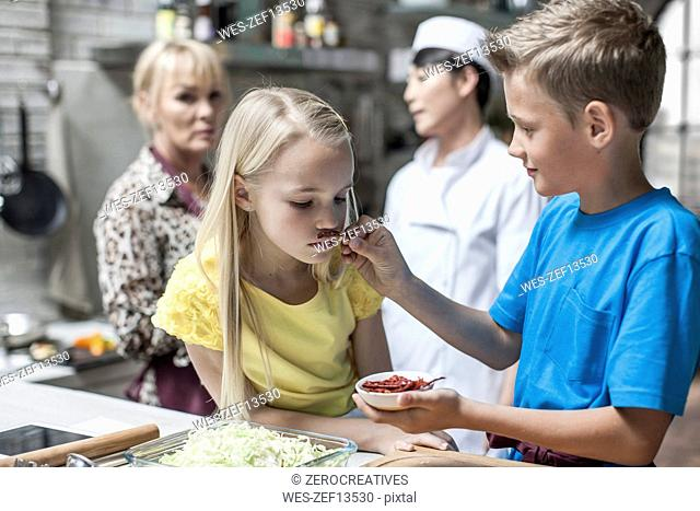 Children smelling chili in cooking class