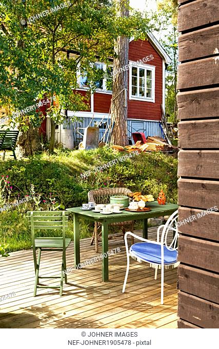 Table and chairs on porch, Sweden