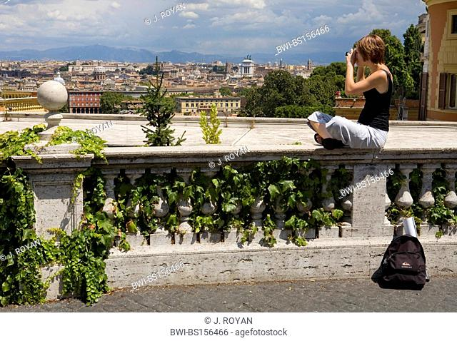 A young Danish tourist girl enjoys the view of Rome from Monte Gianicolo, Italy, Rome