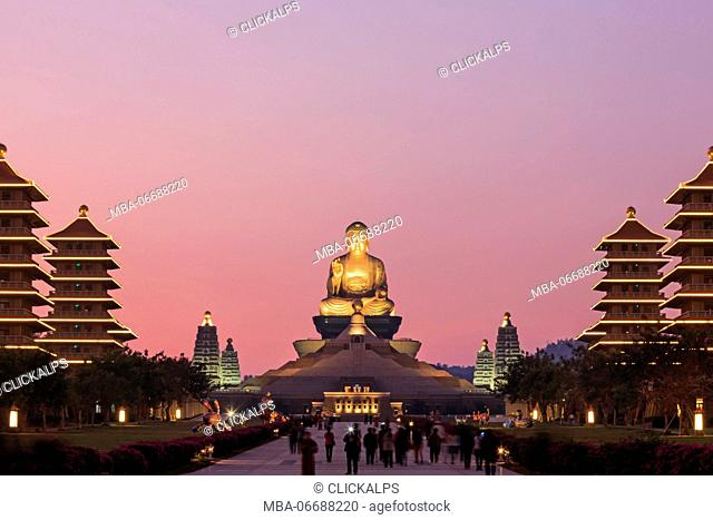 Kaohsiung, Taiwan. Sunset at Fo Guang Shan buddist temple of Kaohsiung with many tourists walking by