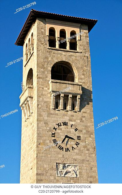 Saint John cathedral,Tower with lion emblem of Venice, engraved on facade, Rhodes town , Rhodes island, Greece