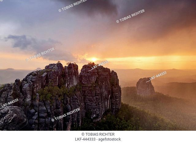 Sunset and rain above Schrammsteine and Falkenstein, National Park Saxon Switzerland, Saxony, Germany