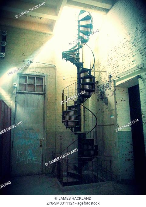 A large spiral staircase found inside an abandoned hydro substation. Ontario, Canada